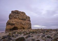 Rocha na costa Imagem de Stock