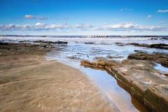 Rochas da baía de Druridge foto de stock