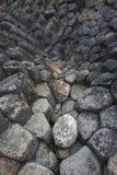 Rochas do mar com testes padrões bonitos raros em Ganh a Dinamarca Dia Phu Yen Province, Vietname fotografia de stock
