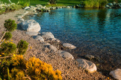 Rochas do ornamento em uma lagoa Fotografia de Stock Royalty Free