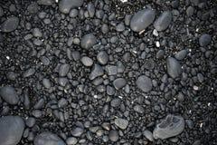 Rochas em uma textura da praia Foto de Stock