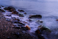 Rochas espectrais no mar Foto de Stock Royalty Free