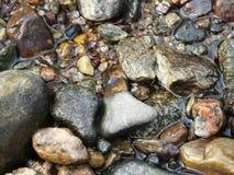 Rochas na água Imagens de Stock Royalty Free