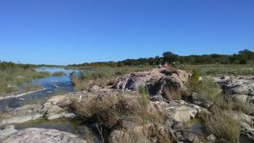 Rochas no rio de Llano perto de Castell, Texas Imagem de Stock