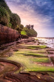 Rochas vulcânicas na praia colorida, ilha de Weizhou Fotos de Stock