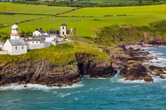Roche`s Point Lighthouse, Hillside View Cork Ireland royalty free stock photo