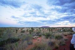 Roche d'Ayers, Australie centrale après lever de soleil Photos stock
