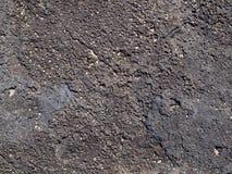 Roche de lave avec des bits de sable sur le dessus Image libre de droits