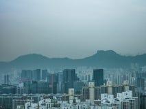 Roche de lion et bâtiment, Hong Kong Photographie stock