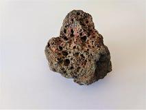Roche foncée de basalte vésiculaire avec des trous
