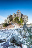 Roche Rock in Cornwall. Tiny ruined chapel perched on a craggy outcrop at Roche Rock in Cornwall Royalty Free Stock Photography