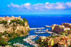 The Rocher, Fontvieille and its port, and the mediterranean sea. This lovely photograph shows Monaco`s Rock, Fontvieille Village residential district, the Royalty Free Stock Photos