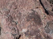 Roches antiques superficielles par les agents rocailleuses dans le Patagonia image stock