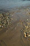Roches et eau abstraites Photos stock