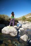 Roches et femme de l'eau Photographie stock libre de droits