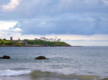 Roches Point. Coastline at White Bay, Co. Cork, Ireland, with Roches Point  in background Royalty Free Stock Photo