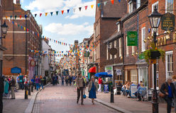 Rochester high street at weekend. People walking through the street, passing cafes, restaurants and shops Stock Images