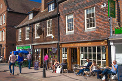 Rochester high street at weekend. People walking through the street, passing cafes, restaurants and shops Stock Image