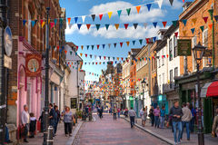Rochester high street at weekend. People walking through the street, passing cafes, restaurants and shops Royalty Free Stock Photo