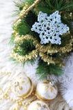 Сrochet snowflake and Christmas-tree decorations Stock Photos