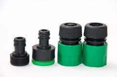 Rociador plástico verde para el jardín con los accesorios Foto de archivo libre de regalías
