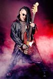 Rock. Heavy metal musician  is playing electrical guitar. Shot in a studio Royalty Free Stock Photo