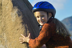 On the rock. Little girl climbing on the rock Royalty Free Stock Images