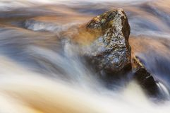 Rock. In the river Stock Photo