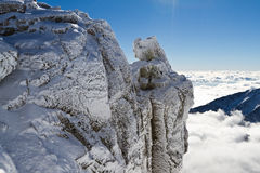 Rock above the clouds. View from Lomnicky Peak (2634 m), High Tatras mountains, Slovakia Royalty Free Stock Photos
