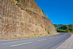 Rock above Road Royalty Free Stock Photography