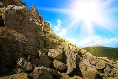 Rock against the solar sky Stock Photos