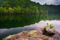 Rock along the shore of Prettyboy Reservoir in Baltimore County, Stock Image