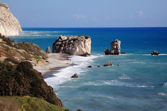 Rock of Aphrodite. (Petra Tou Romiou) the birthplace of Aphrodite the Greek goddess of love, on a shoreline beach of  Western Cyprus between Paphos and Limassol Royalty Free Stock Photos