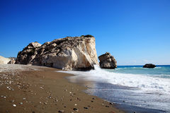 Rock of  Aphrodite. (Petra Tou Romiou) the birthplace of Aphrodite the Greek goddess of love, on a shoreline beach of  Western Cyprus between Paphos and Stock Photo