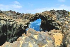 Rock arc. At Graciosa Island, Canaries, Spain Royalty Free Stock Photo