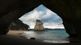 Cathedral cove rock arch north island new zealand. The rock arch at cathedral cove on the north island of new zealand stock video footage