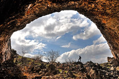 Rock arch. A rock arch and a cave entrance Royalty Free Stock Images