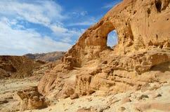 Rock arch in desert Stock Photo