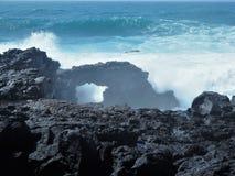 Rock arch in lava near El Golfo, Lanzarote Royalty Free Stock Photography
