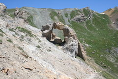 Rock arch near Lacs de Vens with mountain ridge, Maritime Alps (28th July, 2013). Royalty Free Stock Images
