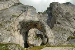 Rock arch. Piatra Craiului mountains, Romania Stock Photo