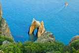 The rock arch in the sea. Stock Photo