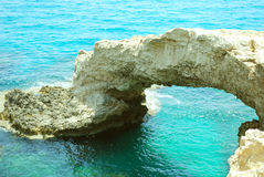 Rock arch with sea water Royalty Free Stock Images