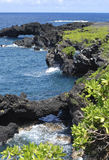 Rock Arches. Rocky coast of black volcanic stone on Maui island, Hawaii stock images