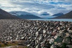 Styggevatnet glacial lake dam with Austdalsbreen glacier in background Jostedalsbreen National Park Sogn og Fjordane Norway stock photography
