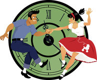 Rock around the clock. Young couple dressed in 1950s fashion dancing rock and roll, clock face on the background Royalty Free Stock Image