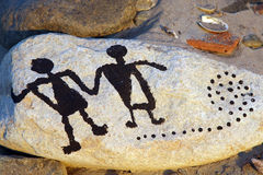 Rock art figures Stock Photos