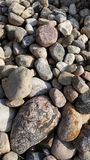 Rock Background. These are multicolor rocks that are at the beach at the lake royalty free stock images