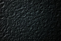 Rock background texture in black. Computer generated charcoal black rock texture for use as background Stock Image