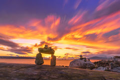 Rock balance on the beach with sunset clouds sky backgrounds Royalty Free Stock Image